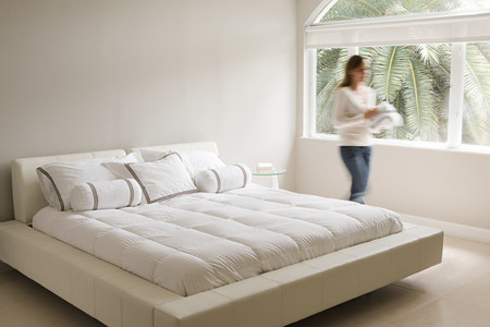 Blurred woman in a bedroom