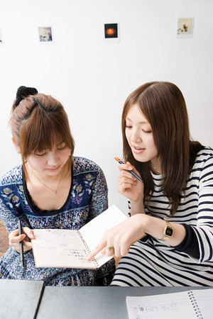 Young women looking at note book Stock Photo
