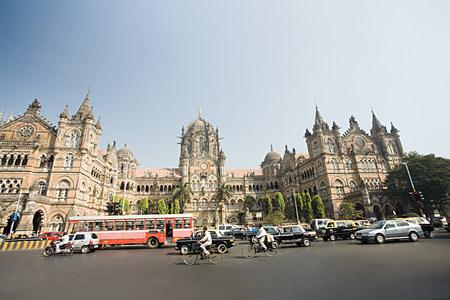 Traffic moving past an ornate church