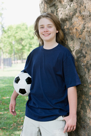 Boy with football Stockfoto