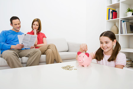 Family with piggy bank Stock Photo