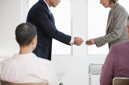 Businesspeople exchanging business cards