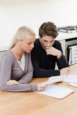 Young couple doing home finances Stock Photo