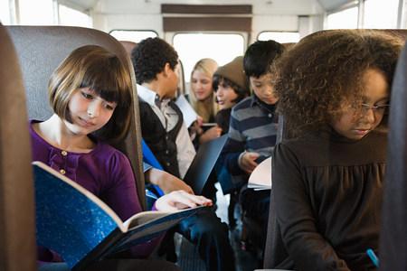 Children on school bus Standard-Bild