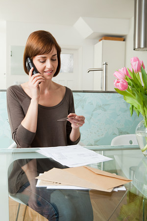 Woman on telephone with credit card 写真素材