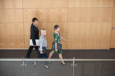 Businesspeople walking through corridor