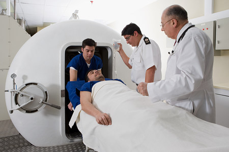 Patient being taken into hyperbaric chamber