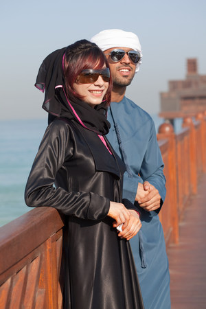 Middle Eastern people and fence, outdoors