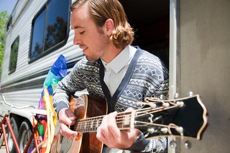 Young man playing guitar Фото со стока