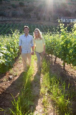 Couple in a sunlit vineyard