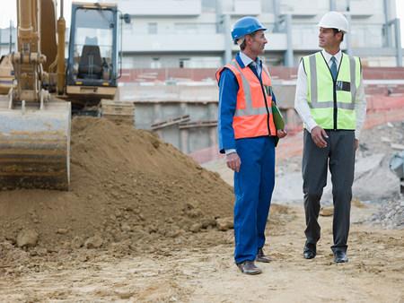Mature men meeting on construction site