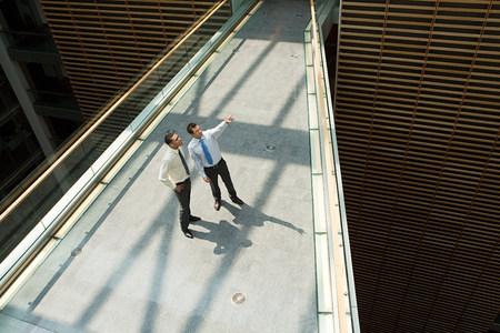 Businessmen on office walkway Banco de Imagens