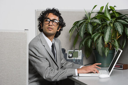 Guilty looking businessman Stock Photo