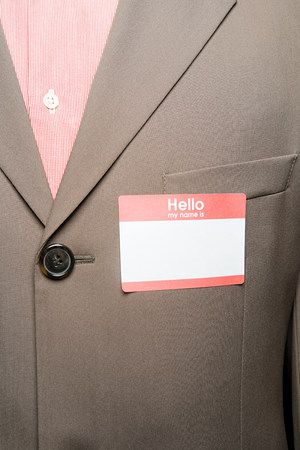 Businessman with blank name tag Banco de Imagens