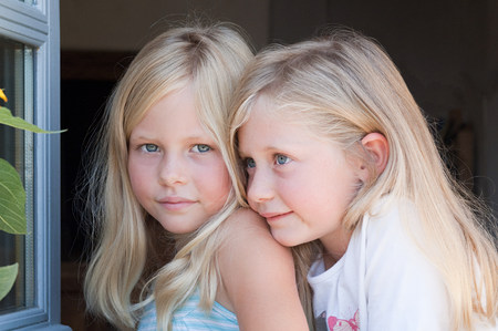 Blond twin girls, portrait Stock fotó