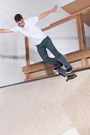 Skateboarder on ramp at skate park