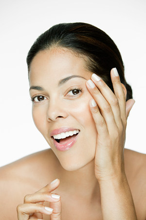 Woman touching her face Фото со стока
