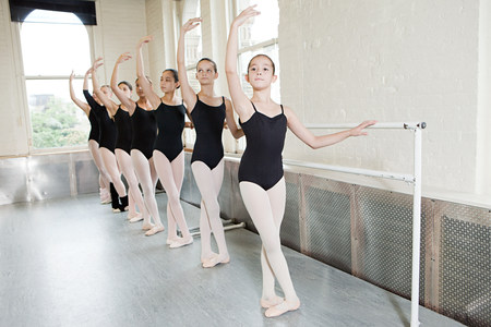 Ballerinas exercising at barre