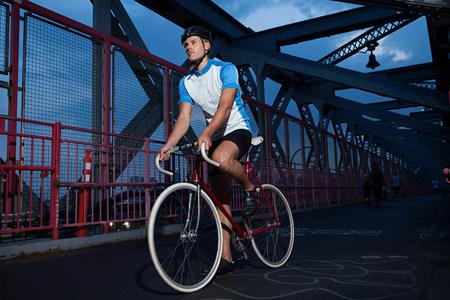 Cyclist riding on bridge Stok Fotoğraf