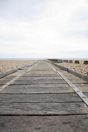 Wooden path leading to sea Фото со стока