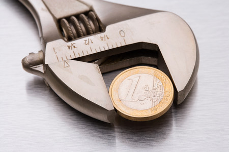 Euro coin in a wrench