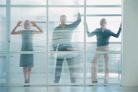 Business people behind glass panel