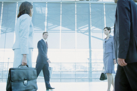 Business people in airport terminal