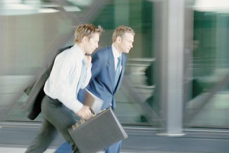 Businessmen walking briskly Фото со стока