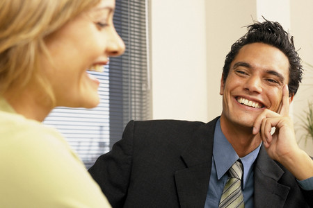 Businessman and businesswoman flirting Stock Photo