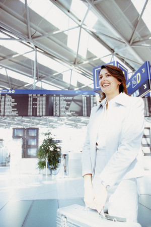 Businesswoman in airport terminal Stock Photo