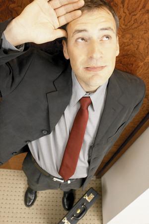 Businessman looking upwards Stock Photo
