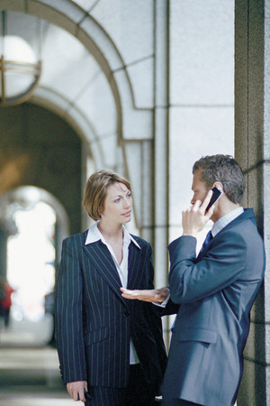 Businessman and businesswoman talking outside office Stock fotó