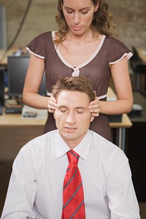 Woman massaging her colleague