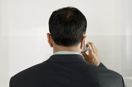 Businessman on cell phone Imagens