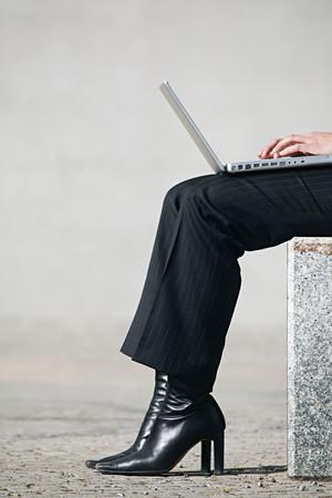 Woman using laptop computer 스톡 콘텐츠