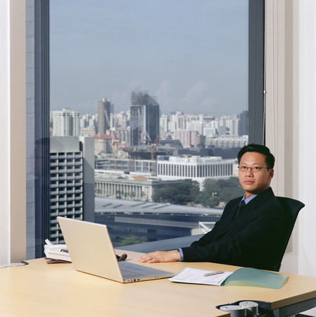 Serious looking businessman in office 스톡 콘텐츠