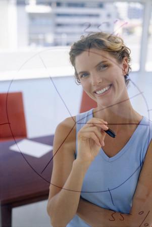 Woman behind diagram drawn on glass