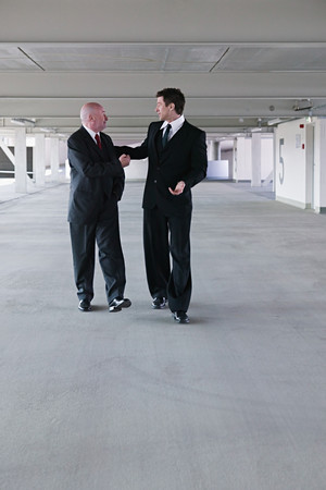Businessmen in a car park 스톡 콘텐츠