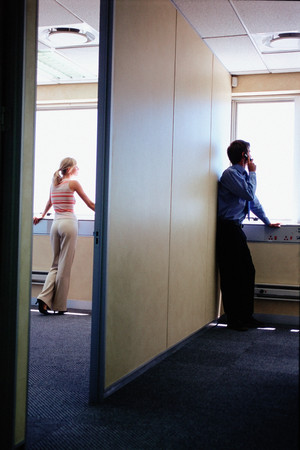 Business people looking out of window