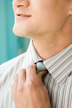 Man adjusting tie Stock Photo