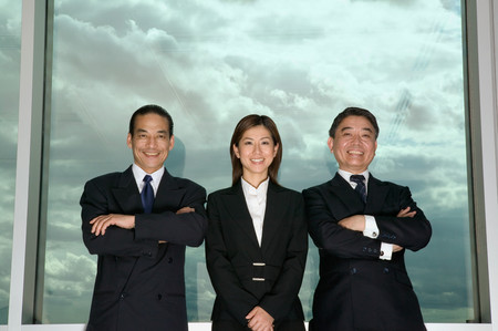 Business people and cloudy sky