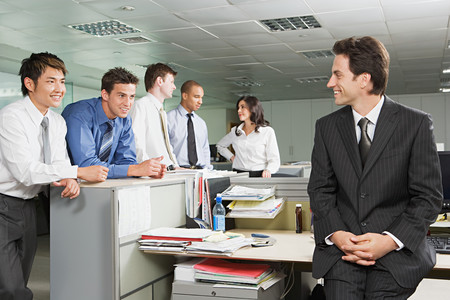 Manager chatting to employees