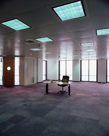 Desk in empty office Stock Photo