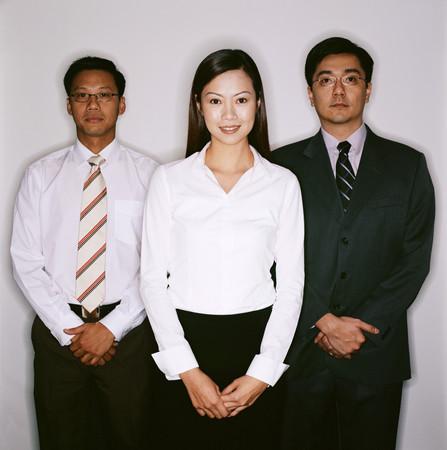 Three business people posing 스톡 콘텐츠