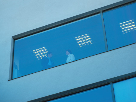 View of businessman through a window 스톡 콘텐츠