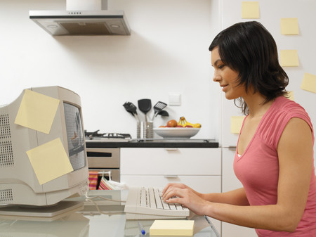 Woman working in the kitchen Stock Photo