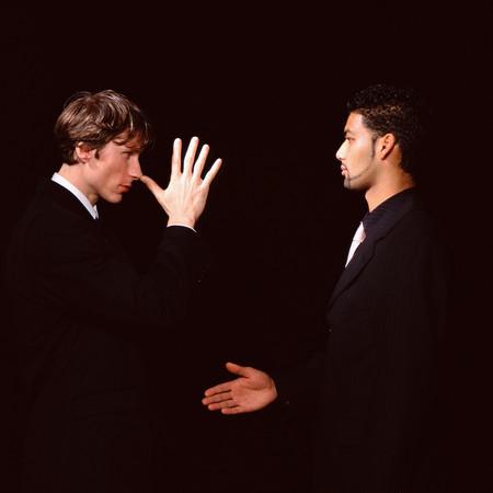Jokey handshake Stock Photo