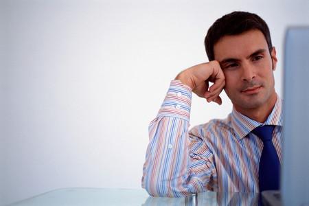 Businessman reading screen