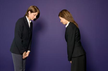 Busineswomen bowing 스톡 콘텐츠