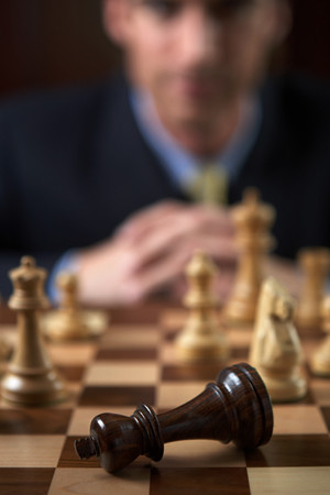 Businessman playing a game of chess